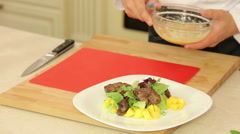Cooking salad with chicken liver and mango Stock Footage