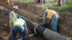 Oil field construction crew cuts a large oil pipeline Stock Footage