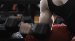 muscular man working out with dumbbells - stock footage