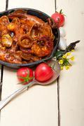 fresh seafoos stew on an iron skillet - stock photo