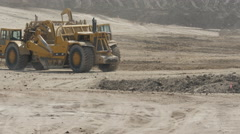 Earthmover picking up dirt - stock footage