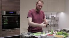 Man prepares fish steaks Stock Footage