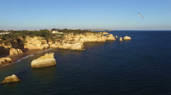 Aerial from rocks and ocean at Praia tres Irmaos in Alvor Portugal Stock Footage