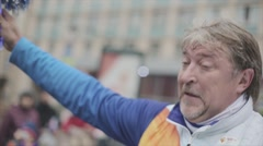 Aged man wave pom pom, give it adult woman. Relay race of Sochi Olympic flame in - stock footage