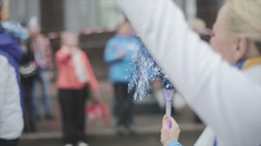 Young girl shake pom pom, smile in camera. Relay race of Sochi Olympic flame in - stock footage