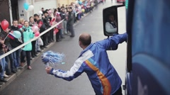 Boy shake pom pom stay at door of driving bus. Relay race of Sochi Olympic flame - stock footage
