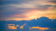 The flow of cloud against the sunset. Time lapse - stock footage
