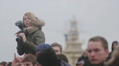Many people stay on street. Girl with camera sit on shoulders. Photographers Stock Footage