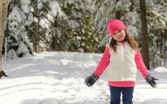 Portrait of a little girl  in winter - stock photo