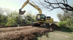 Track hoe works on an pipeline construction site Stock Footage