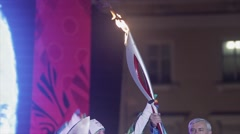 Relay race Olympic flame in Saint Petersburg. Egorova and Poltavchenko ignite Stock Footage
