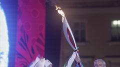 Relay race Olympic flame in Saint Petersburg. Egorova and Poltavchenko ignite - stock footage