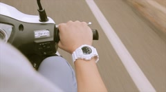 View at hand of man on steering wheel drive motorbike. Traveling. White watch Stock Footage