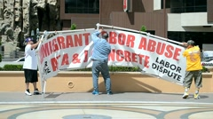 People with immigrant labor abuse placard, Las Vegas Strip, Las Vegas, USA. Stock Footage