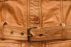 Texture a shabby brown leather jacket. - stock photo
