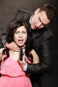Scene of violence with firearm between men and women. - stock photo