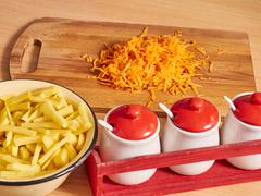 Grated carrots on table. potatoes in  plate Stock Photos