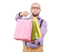 Man  with colorful shopping paper bags Stock Photos