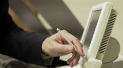 closeup of businessman pressing the touch screen of a large printer 4k - stock footage
