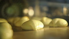 Baking buns in the oven - stock footage