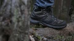Female hiker and a closeup of a hiking shoe Stock Footage