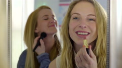Girls Use Mirror To Apply Makeup, They Have Fun Getting Ready Stock Footage