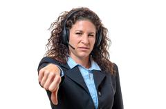 Young businesswoman signalling her disgust - stock photo