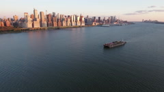 Sunset Shot With Oil Rig Ship On Hudson River With NYC In View Stock Footage