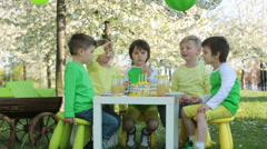 Happy sweet preschool children, celebrating fifth birthday of cute boy Stock Footage