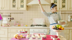 Girl having fun with utility whisk - stock footage