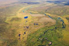 Aerial photo of a river catchment with small ponds in the mires - stock photo