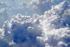 clouds view from the window of an airplane - stock photo
