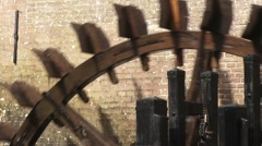 Vertically mounted water wheel rotated by streaming water Stock Footage