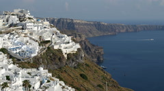 Greece Santorini Fira caldera rim little boat leaving Stock Footage