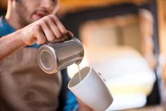Pleasant barista working in the cafe Stock Photos