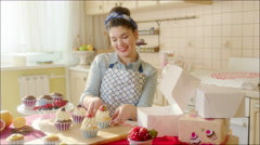 Positive girl putting cake in the box - stock footage