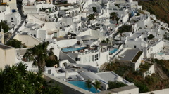 Greece Santorini Fira inns with pools Stock Footage