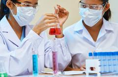 Scientists experimenting in laboratory Stock Photos