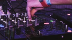 Dj spinning at turntable, mix on party in nightclub. Cheering. Equipment. Dance - stock footage