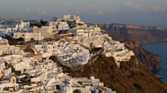 Greece Santorini Fira on caldera rim in late afternoon light Stock Footage