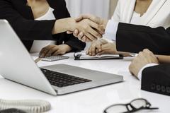 business people having handshake - stock photo
