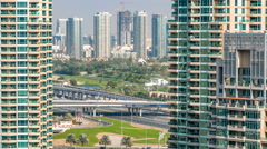 Golf field timelapse from top at day time with traffic on sheikh zayed road Stock Footage