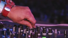 Dj mixing at turntable on party in nightclub. Cheering. Equipment. Red watch - stock footage