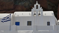 Greece Santorini Saint Nicholas church and flag Stock Footage