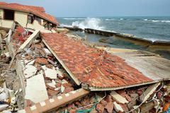 Erosion, climate change, broken building, Hoi An, Vietnam - stock photo