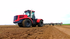 Tractors preparing land for sowing 4K, UHD Stock Footage
