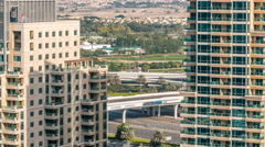 Golf field timelapse from top at day time with traffic on sheikh zayed road - stock footage