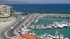 Greece Crete Heraklion boats in harbor by road Stock Footage