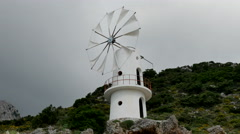 Greece Crete Lasithi Plateau traditional windmill turning Stock Footage