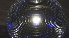 Disco ball reflect blue beams from spotlight on party in nightclub - stock footage